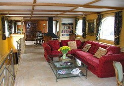 La Bonne Humeur salon features a Bose CD system, a cozy bar, and great library, providing the amenities of a yacht on one of the most beautiful canals in France.