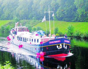 Captain Dan pilots the Scottish Highlander, our luxurious home for the week, along the Caledonian Canal